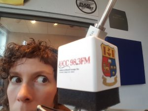 Songwriter Ciara O'Flynn looking a little cheeky and nervous as she cosies up to the microphone in the studio at Campus Radio